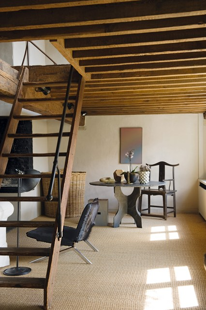 Loft extension with wooden steps.